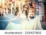 white dress  | Shutterstock . vector #233427802