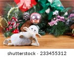 Toy Sheep Lies At New Year...