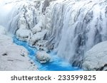 Small photo of Frozen waterfall with clea blue water at early spring, Gullfoss, Iceland