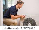 focused handyman fixing air... | Shutterstock . vector #233622622