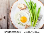 green asparagus with fried egg... | Shutterstock . vector #233640562