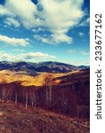 late afternoon in mountains in... | Shutterstock . vector #233677162