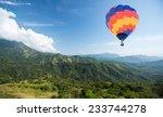 hot air balloon over mountain...   Shutterstock . vector #233744278