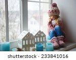 Little Girl On A Window Sill...