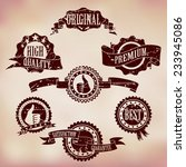 grunge scratched badges on... | Shutterstock .eps vector #233945086