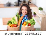 young woman holding grocery... | Shutterstock . vector #233951632
