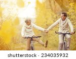 active seniors riding bike in... | Shutterstock . vector #234035932