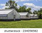 A Group Of Greenhouses On A...