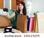 smiling girl with  purchases at ... | Shutterstock . vector #234115255