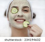 A Young Woman With A Face Pack.
