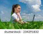 girl with laptop on green grass ... | Shutterstock . vector #234291832