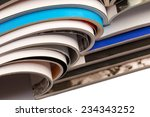 Stack of magazines on white background with reflection - stock photo