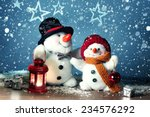 Two Smiling Snowmen  In The...