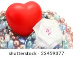 Red valentine heart,colorful pearls,beads,white ribbon. - stock photo