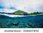 diver below the surface in... | Shutterstock . vector #234607852