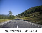 Asphalt sunny road going into the perspective - stock photo