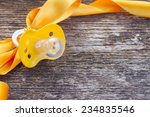 baby yellow soother with ribbon ... | Shutterstock . vector #234835546