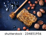 Honeycomb With Honey Dipper An...