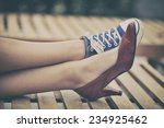 woman legs in different shoes | Shutterstock . vector #234925462
