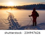 Skier In Sunset