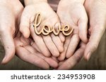 hands holding word love  | Shutterstock . vector #234953908