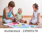 mother and siblings painting... | Shutterstock . vector #235005178