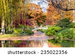 arched wooden bridge accented... | Shutterstock . vector #235022356