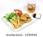 chicken nuggets with salad, tomato and fries - stock photo