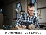 young craftsman in uniform... | Shutterstock . vector #235124938