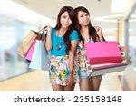 happy shopping girl holding... | Shutterstock . vector #235158148