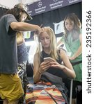 Small photo of New York - September 05, 2014: Katya Riabinkina prepares backstage at the Monique Lhuillier Spring 2015 fashion show during Mercedes-Benz Fashion Week at The Theatre at Lincoln Center