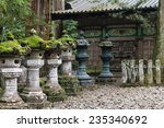 moss covered stone lanterns at...