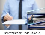 binders with papers are waiting ... | Shutterstock . vector #235355236