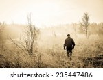 man in a misty landscape | Shutterstock . vector #235447486