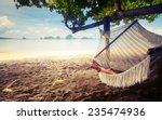 young lady relaxing in the... | Shutterstock . vector #235474936