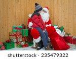 a boy visiting santa in his... | Shutterstock . vector #235479322