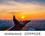 hand holding sunset and city of ... | Shutterstock . vector #235594228