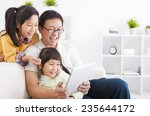 happy father using tablet pc... | Shutterstock . vector #235644172