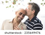 portrait of a happy gay couple... | Shutterstock . vector #235649476