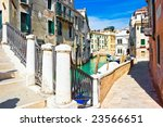 Small bridge over greenish water of a venetian canal, Italy - stock photo