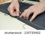 Male Tailor Hands Working With...