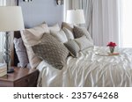 Stock photo luxury bedroom with tray of flower on bed 235764268