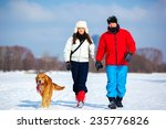 Young Couple Walking With Dog....
