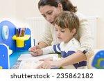 mother helping her kid to make... | Shutterstock . vector #235862182