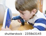 little boy using diy tool at... | Shutterstock . vector #235863145