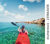kayaking. the woman floating on ... | Shutterstock . vector #235863658