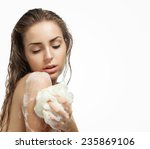 beautiful girl washing her body ... | Shutterstock . vector #235869106