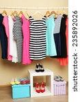 female dresses on hangers in... | Shutterstock . vector #235892026