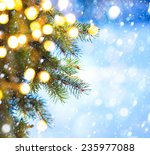 christmas tree branch on a blue ... | Shutterstock . vector #235977088