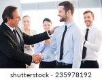 good job  two cheerful business ... | Shutterstock . vector #235978192